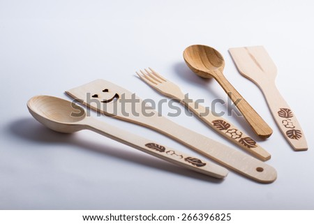 Collection of wooden kitchen utensils  on white background. - stock photo