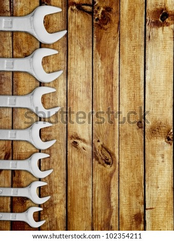 Collection of wrench on wood background