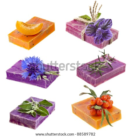 Collection set of  different handmade soaps with fresh herbs  isolated on white background