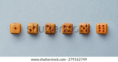 Collection wooden dices organized in a line over blue background, above view - stock photo