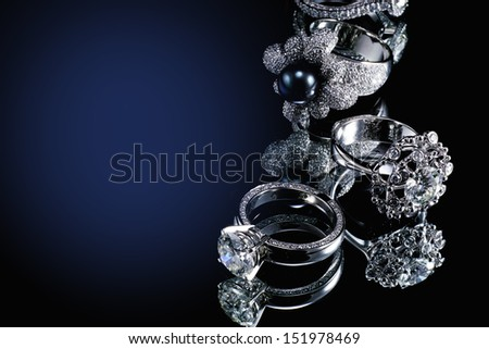 Collections of rings with diamond isolated on black background  - stock photo