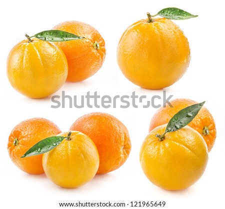 Collections of Ripe orange fruit with leaf and water drops isolated on white background - stock photo