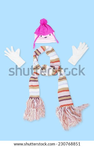 Collections of winter clothing accessories consist of knitted scarf, gloves, and hat - stock photo