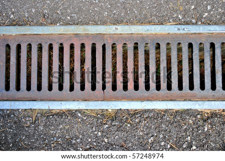 collector for collection of rainwater iron and cement - stock photo
