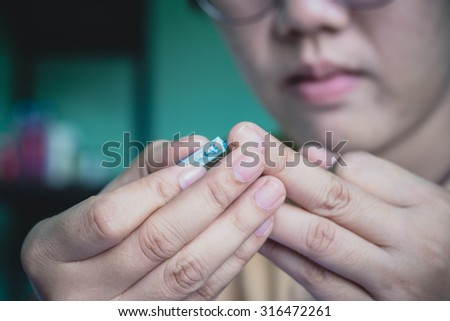 collects blood specimen from a finger - stock photo