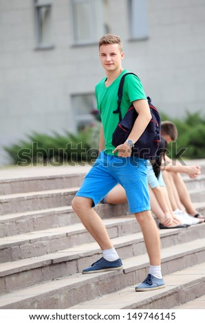 College boy outdoors - stock photo
