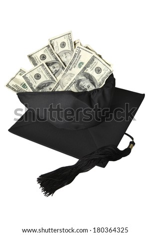 College cap and tassel with american dollar bills on white background - stock photo