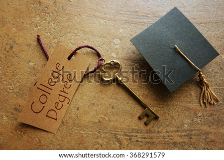College degree key with graduation cap                                - stock photo