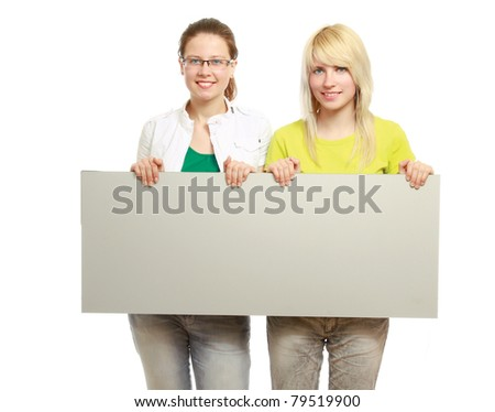 College girls holding a blank, isolated on white - stock photo