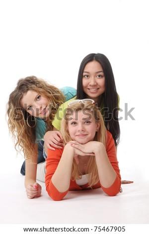 College girls lying on the floor - stock photo
