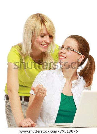 College girls with a laptop, isolated on white