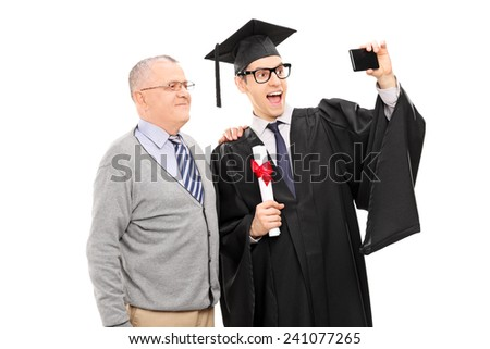 College graduate taking a selfie with his father isolated on white background - stock photo