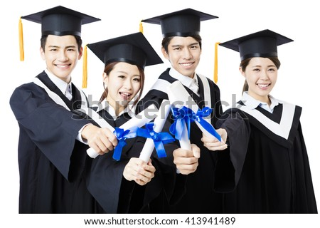 college graduates in graduation gowns standing  and smiling - stock photo