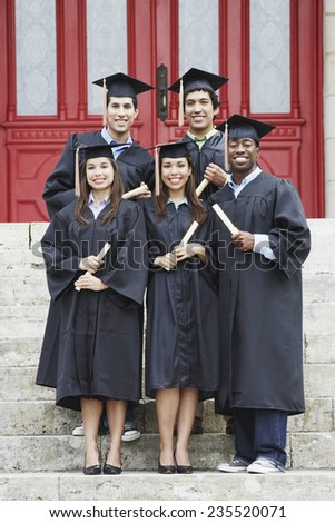 College Graduates Proudly Holding Diplomas - stock photo
