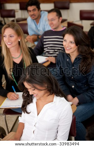 college or university students in a classroom studying - stock photo