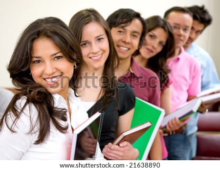 college or university students in a row with notebooks - stock photo