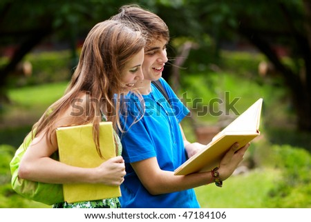 college or university students studying outdoors - stock photo