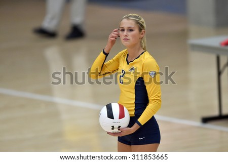 COLLEGE PARK, MD - AUGUST 28: Kent State libero/defensive specialist Sam Jones (2) prepares to serve during the NCAA women's volleyball game August 28, 2015 in College Park, MD.  - stock photo