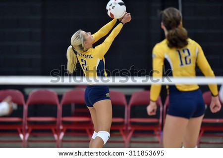 COLLEGE PARK, MD - AUGUST 28: Kent State libero/defensive specialist Sam Jones (2) sets a ball during the NCAA women's volleyball game August 28, 2015 in College Park, MD.  - stock photo