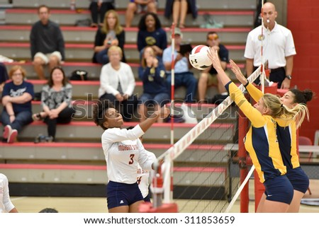 COLLEGE PARK, MD - AUGUST 28: Morgan State opposite Haley McClure (3) has a spike blocked by Kent State during the NCAA women's volleyball game August 28, 2015 in College Park, MD.  - stock photo