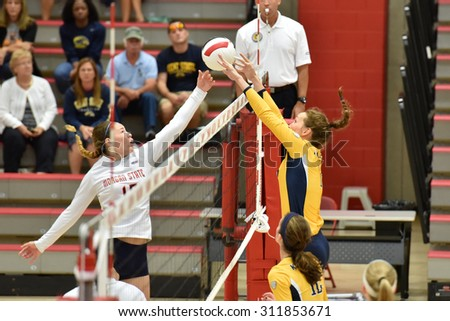 COLLEGE PARK, MD - AUGUST 28: Morgan State outside hitter Michaela Collins (15) has a spike blocked by Kent State during the NCAA women's volleyball game August 28, 2015 in College Park, MD.  - stock photo