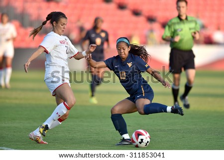 COLLEGE PARK, MD - AUGUST 28: West Virginia Carla Portillo (10) tries to avoid a Terp defender during the NCAA women's soccer game August 28, 2015 in College Park, MD.  - stock photo