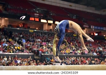 COLLEGE PARK, MD - JANUARY 9: WVU gymnast Brooklyn Doggette performs on the balance beam during a meet January 9, 2015 in College Park, MD.  - stock photo