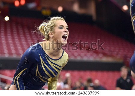 COLLEGE PARK, MD - JANUARY 9: WVU gymnast Melissa Idell cheers on a teammate on the floor exercise during a meet January 9, 2015 in College Park, MD.  - stock photo