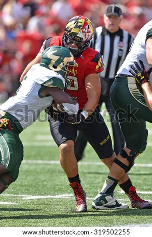 COLLEGE PARK, MD - SEPTEMBER 19: Maryland Terrapins defensive lineman Roman Braglio (90) tackles a ball carrier during a NCAA football game September 19, 2015 in College Park, MD.