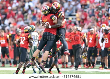 COLLEGE PARK, MD - SEPTEMBER 19: Maryland Terrapins defensive linemen Roman Braglio (90) and Yannick Ngakoue (7) celebrate a victory during a NCAA football game September 19, 2015 in College Park, MD.