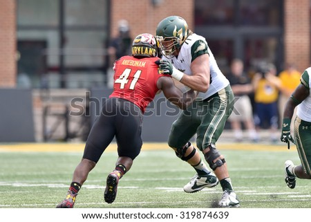 COLLEGE PARK, MD - SEPTEMBER 19: South Florida Bulls offensive lineman Mak Djulbegovic (71) blocks in pass protection during a NCAA football game September 19, 2015 in College Park, MD.  - stock photo