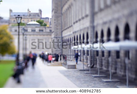 college people  in the park. blurred students in the courtyard of the university. Abstract blur people in outdoor - stock photo