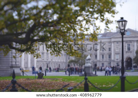 college people  sitting in the park. blurred students in the courtyard of the university. Abstract blur people in outdoor. blurred students in the courtyard of university campus - stock photo