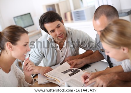 College people studying together in school lounge