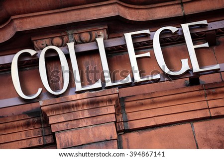 College sign, entrance to old university building, closeup - stock photo