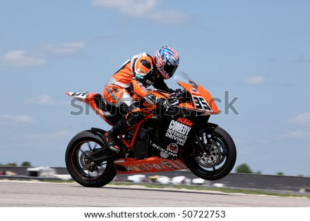 COLLEGE STATION, TX - APRIL 10: Pre-race favorite RideSmart team bike lifts the front wheel in the six-hour race for super bikes at Texas World Speedway April 10, 2010 in College Station, TX - stock photo