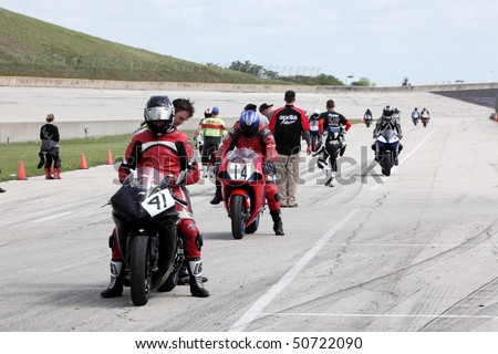 COLLEGE STATION, TX - APRIL 10: Racers line up on the starting grid for the six-hour endurance race for super bikes at Texas World Speedway April 10, 2010 in College Station, TX - stock photo