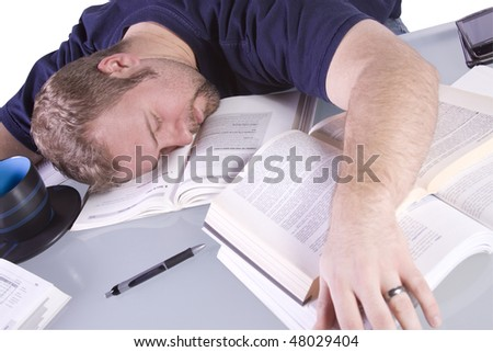 College Student Falling Asleep while Studying for his Finals - Isolated Background - stock photo
