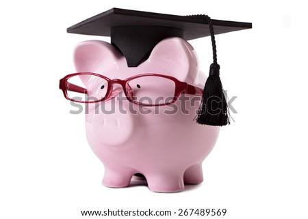 College student graduate concept, piggy bank - stock photo