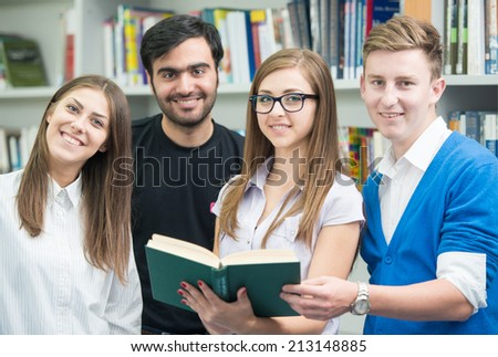 College student on university campus having a teamwork research - stock photo