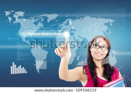 College student pressing the 'future starts here' button on modern touchscreen interface - stock photo