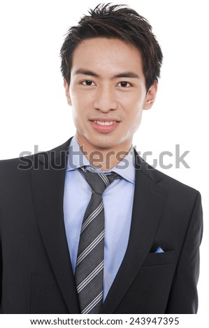 college student standing at his university - stock photo