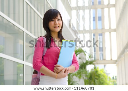 College Student standing outside college building