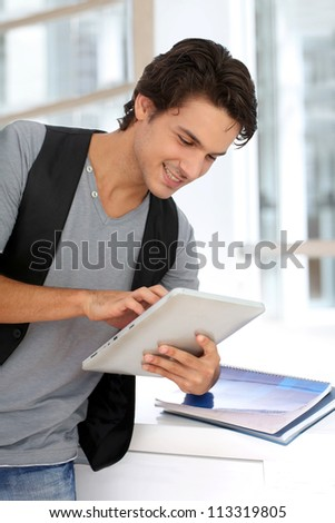 College student using digital tablet at school - stock photo