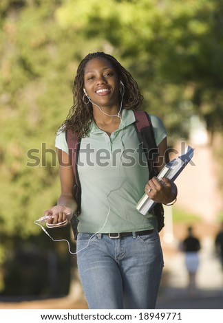 College student walking between classes - stock photo
