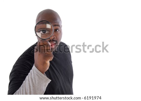 College student with a magnifying glass; isolated on white - stock photo