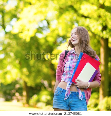College student with books and folders.