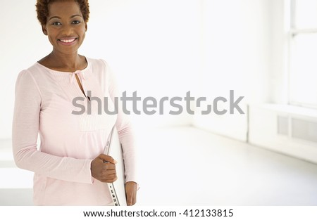 college student with laptop walking over white background - stock photo
