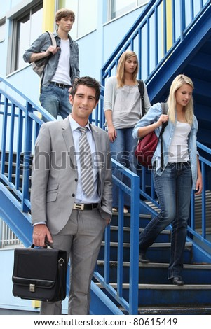 College students and young professor - stock photo