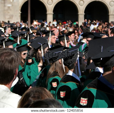College students during graduation - stock photo